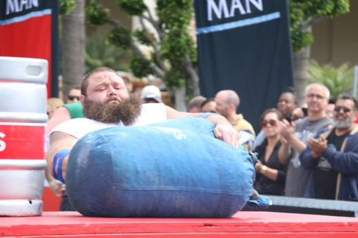 1. Robert Oberst struggling to lift a sack onto a table