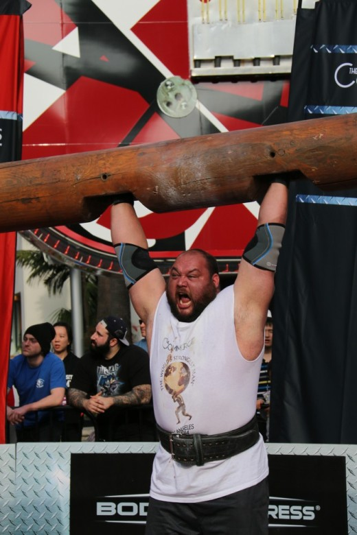 2. Gerhard van Staden roaring as he lifts a log above his head
