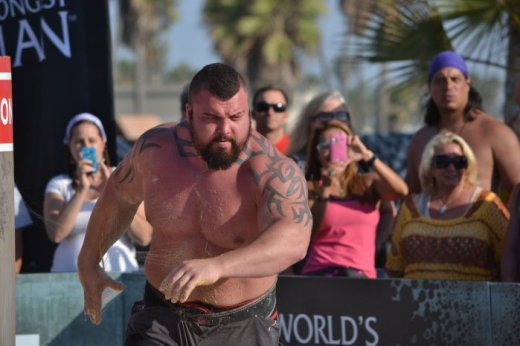 3. Eddie Hall covered in sticky glue running between lifts