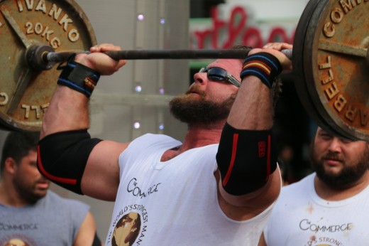 4. Mike Burke lifting a bar above his head