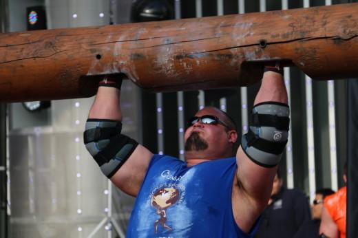 7. Brian Shaw lifting a log above his head